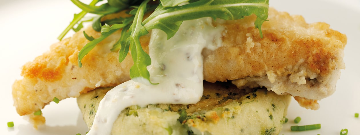 Roasted Monkfish served on Broccoli Potato Cakes with a Yoghurt Dressing