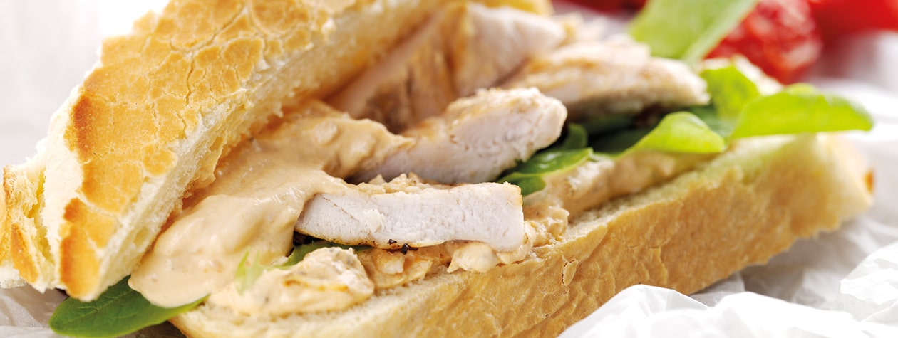 Warm Chicken Sandwich, with a Sun Blush Tomato, Roast Garlic & Yoghurt Dressing